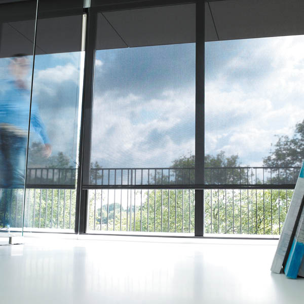 Roller window blinds from Shutterstyle in sheer charcoal fabric