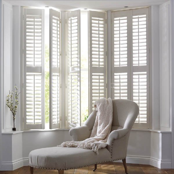 large full height shutters with sofa