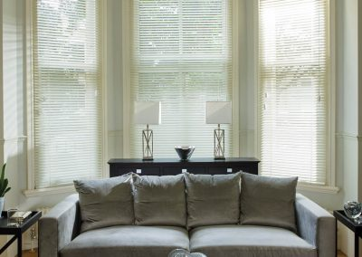 Wooden Venetians in a bay window