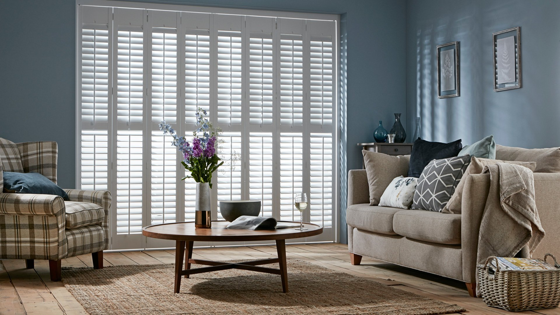 Full Height tracked shutters closed by Shutterstyle